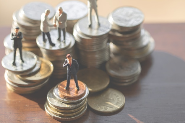 Uomini d'affari sulle monete
