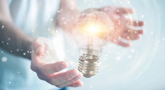 Uomo d'affari che collega le lampadine moderne con le connessioni