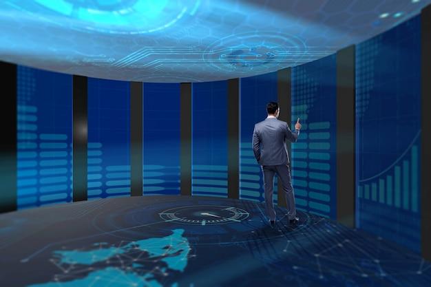 Uomo d'affari che preme i bottoni virtuali nel concetto futuristico
