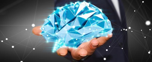 Uomo d'affari che tiene cervello umano dei raggi x digitali nella sua rappresentazione della mano 3d