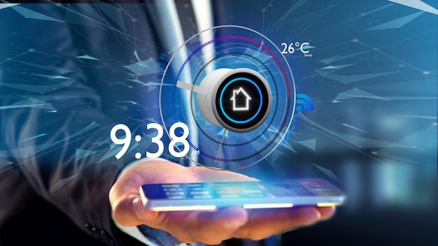 Uomo d'affari che tiene un bottone di una domotica astuta app sopra una rappresentazione dello smartphone 3d