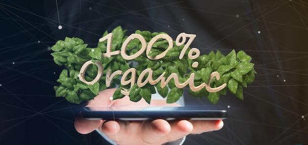 Uomo d'affari che tiene un logo in legno 100% organico con foglie intorno