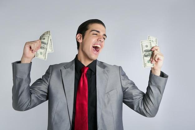 Uomo d'affari con il vestito e il legame delle note del dollaro