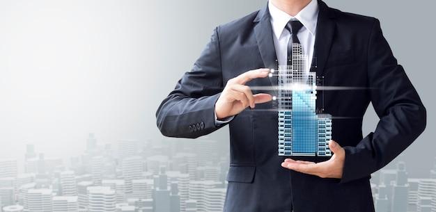 Uomo d'affari creare design moderno edificio