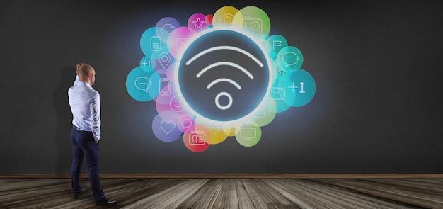 Uomo d'affari davanti ad un'icona di wifi che circonda dalla rappresentazione dell'icona 3d di media sociali del colorfull