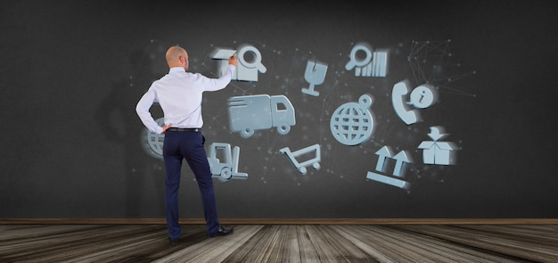 Uomo d'affari davanti ad un'organizzazione logistica con la rappresentazione della connessione 3d e dell'icona
