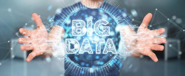 Uomo d'affari facendo uso della rappresentazione dell'ologramma 3d di big data