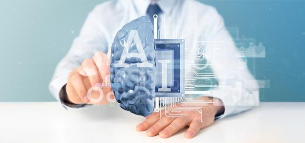 Uomo di affari che tiene l'icona di intelligenza artificiale con la metà del cervello e la rappresentazione del mezzo circuito 3d