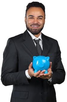 Uomo di affari dell'afroamericano che tiene un porcellino salvadanaio