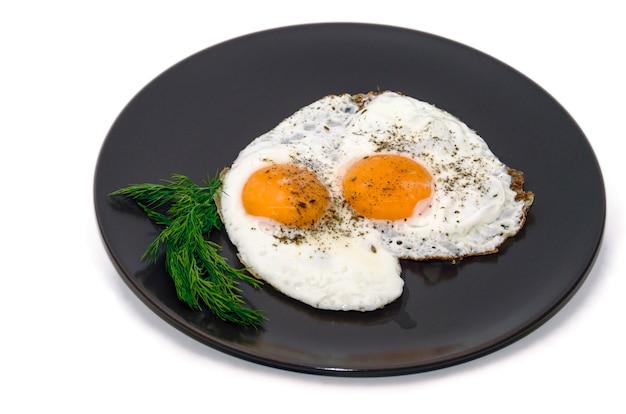 Uova fritte sul piatto