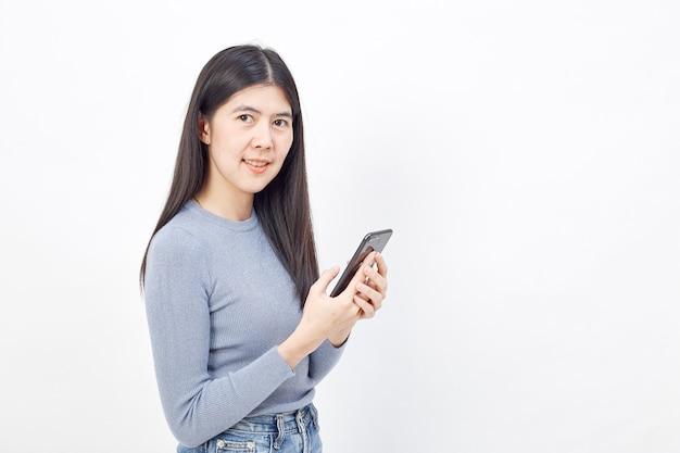 Uso asiatico della donna del cellulare