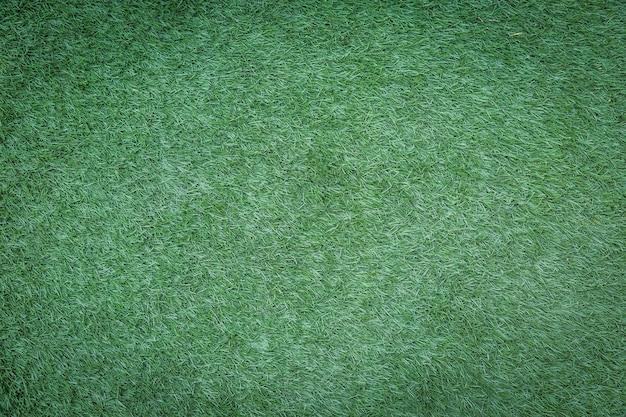 Uso di erba verde artificiale per lo sfondo