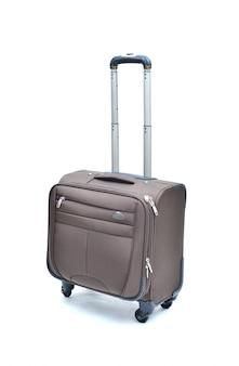 Valigia del computer portatile del rullo di brown isolata su bianco