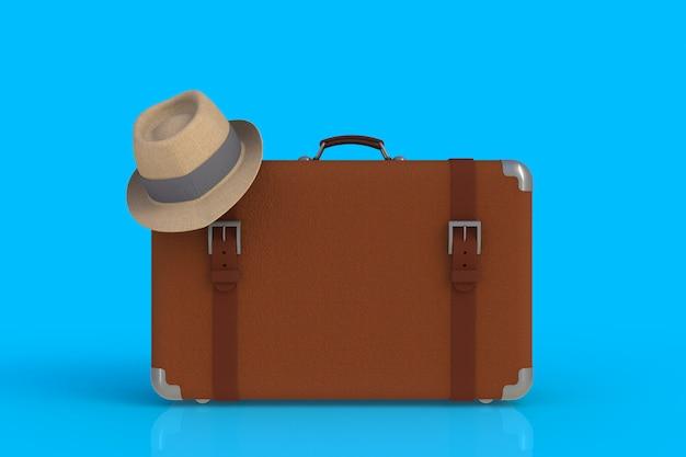 Valigia di un viaggiatore con cappello di paglia