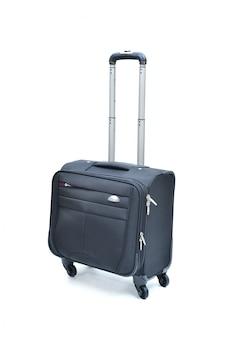 Valigia nera del computer portatile del rullo isolata su bianco