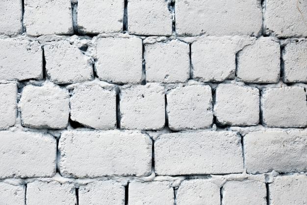 Vecchia fine bianca del fondo di struttura del muro di mattoni su.