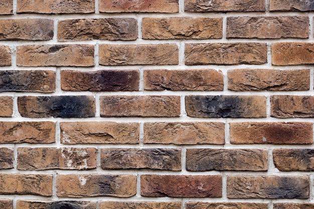 Vecchia priorità bassa del muro di mattoni del grunge dell'annata