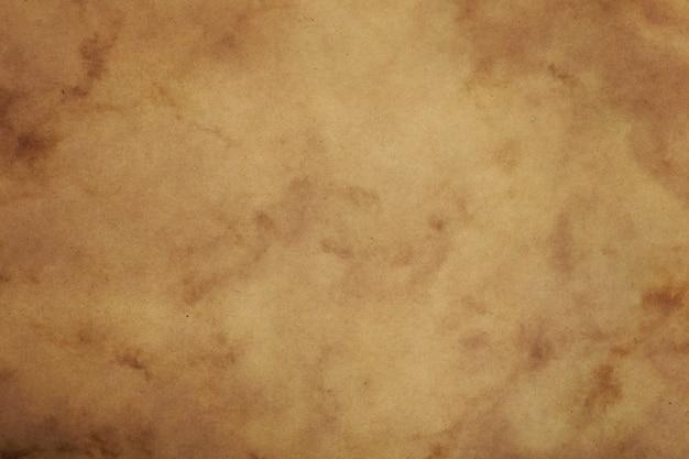Vecchia priorità bassa della pergamena del documento marrone dell'annata