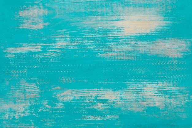 Vecchia priorità bassa di legno nel colore blu-chiaro.