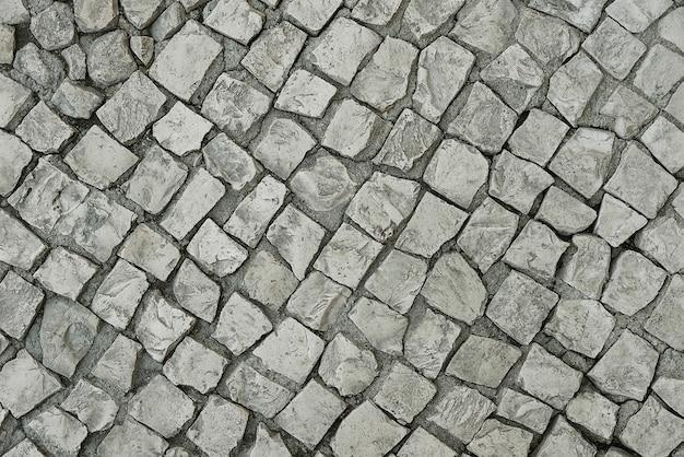 Vecchia priorità bassa di pavimentazione di pietra grigia