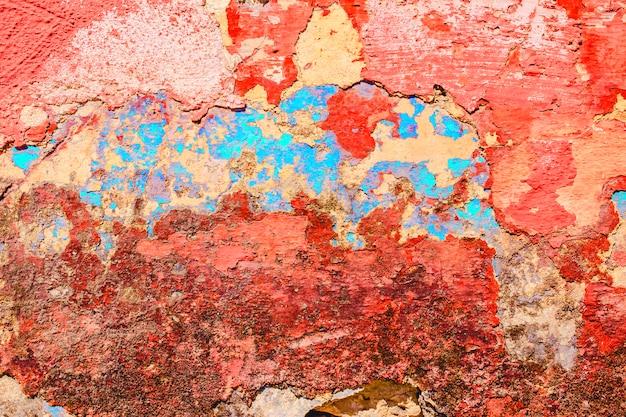 Vecchia sbucciatura della vernice dalla priorità bassa di struttura della parete