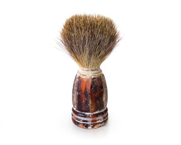 Vecchia spazzola da barba isolata