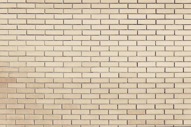 Vecchia struttura beige del fondo del muro di mattoni