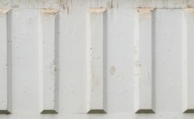 Vecchia struttura decorata bianca della parete della facciata concreta