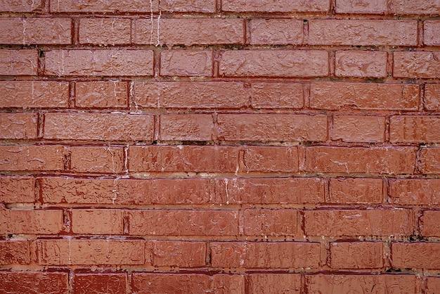 Vecchia struttura del fondo del muro di mattoni dipinta rosso scuro