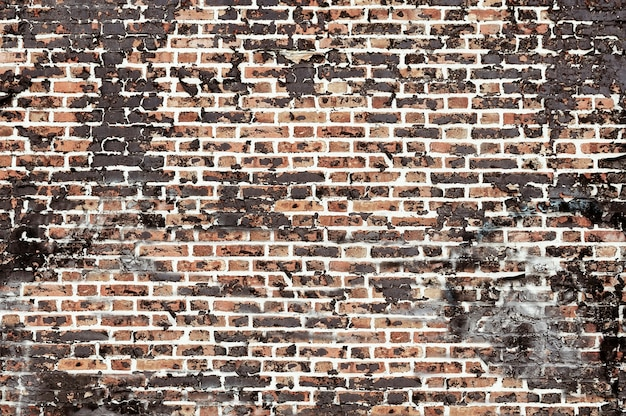 Vecchia struttura del fondo del muro di mattoni rosso