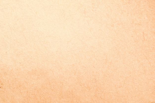 Vecchia struttura di carta beige ruvida del fondo di lerciume per progettazione