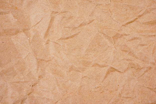 Vecchia struttura di carta sgualcita marrone del fondo