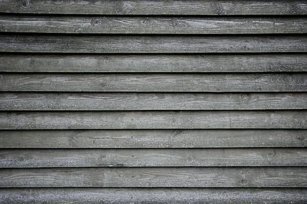 Vecchia struttura di legno grigia della parete