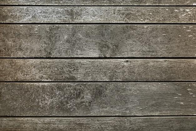 Vecchia struttura di legno grigio scuro del fondo del recinto