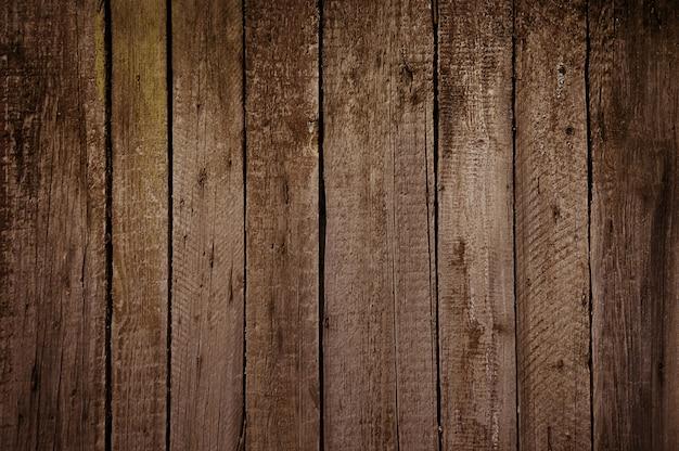 Vecchia struttura di legno marrone della parete