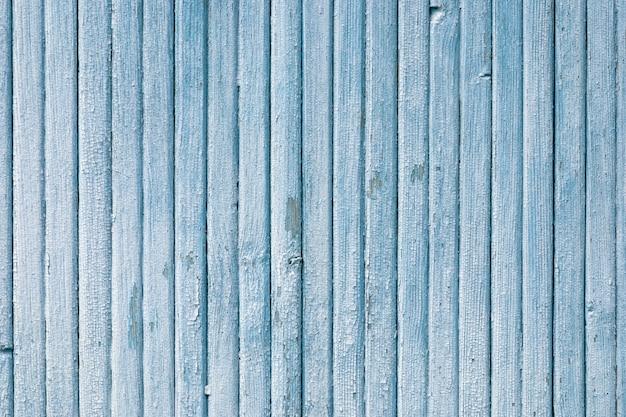 Vecchia struttura di legno verticale blu delle plance