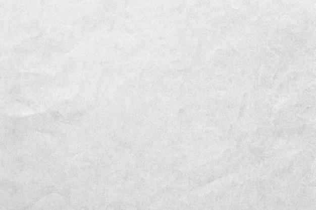 Vecchia struttura grigia del fondo della carta granulosa