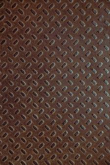 Vecchia struttura marrone astratta del metallo con il modello