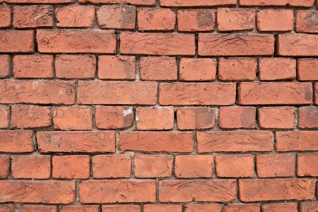 Vecchia struttura rossa del fondo del muro di mattoni