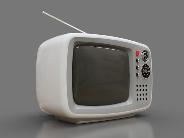 Vecchia tv bianca sveglia con l'antenna su un fondo grigio