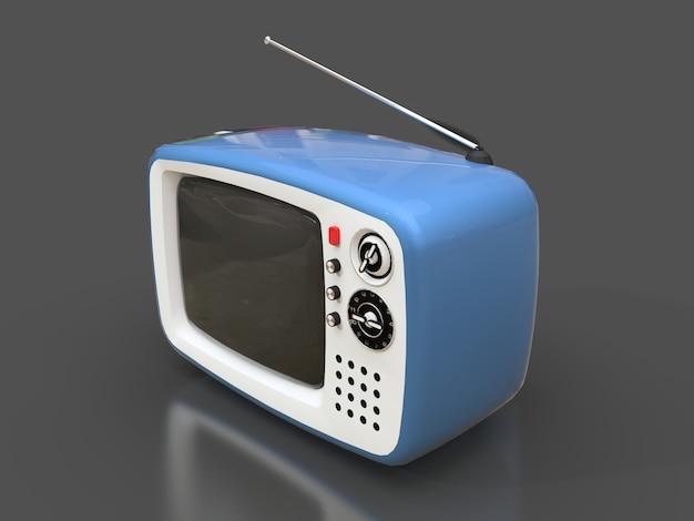 Vecchia tv blu sveglia con l'antenna su una superficie grigia