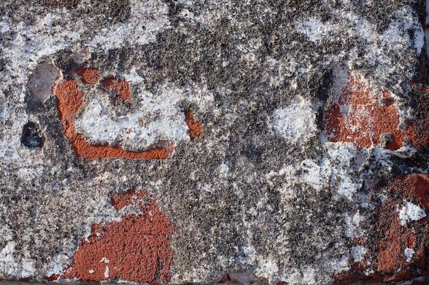 Vecchia vernice scheggiata sul muro