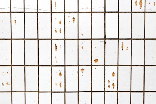Vecchie piastrelle di ceramica incrinate astratte