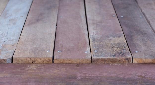 Vecchie strutture di legno grungy d'annata marrone-rosso degli ambiti di provenienza
