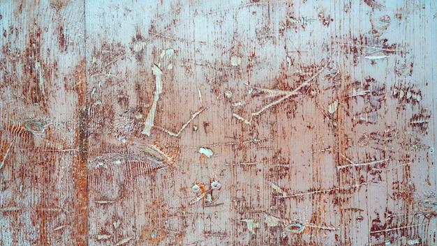 Vecchie tavole di legno con graffi.