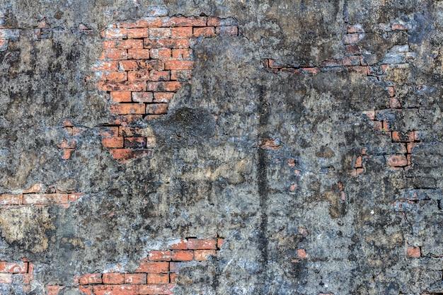 Vecchio estratto di mattoni neri. sfondo di muro di mattoni struttura del muro di mattoni di lerciume. muro di mattoni grigio scuro. modello di muro di mattoni
