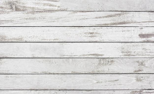 Vecchio fondo bianco di struttura della superficie della pittura della plancia di legno staccata