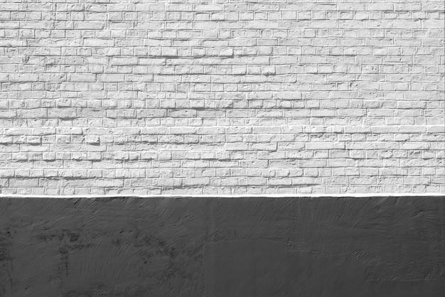 Vecchio fondo bianco e nero del muro di mattoni