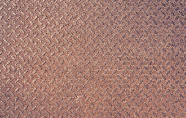 Vecchio fondo d'annata del metallo del piatto del diamante arrugginito del ferro strutturato