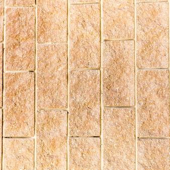 Vecchio fondo del primo piano del muro di mattoni